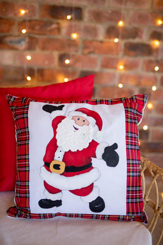 Santa with open arms hand tartan painted Christmas cushion.