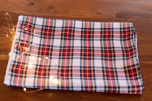 White tartan table runner for Christmas table setting