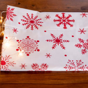 White runner with red snowflakes table runner