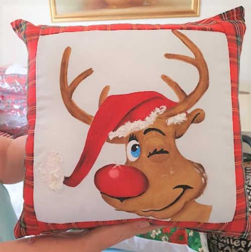 Winking reindeer hand painted Christmas cushion