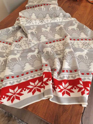 Knitted grey and red Christmas blanket