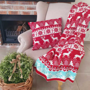 Knitted red & turquoise Christmas blanket